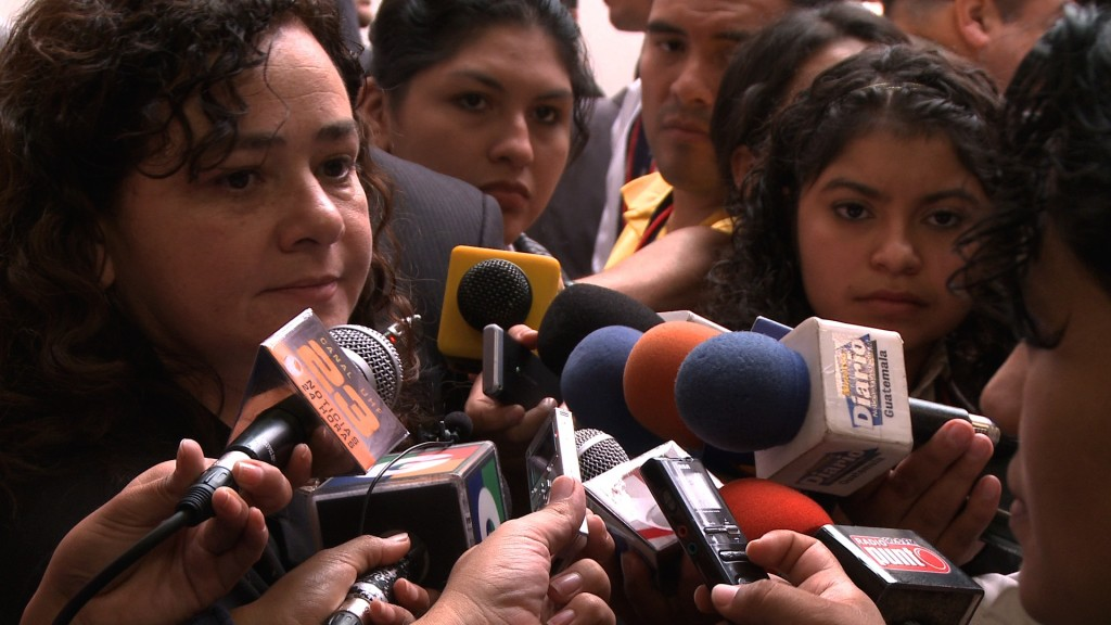claudia with press