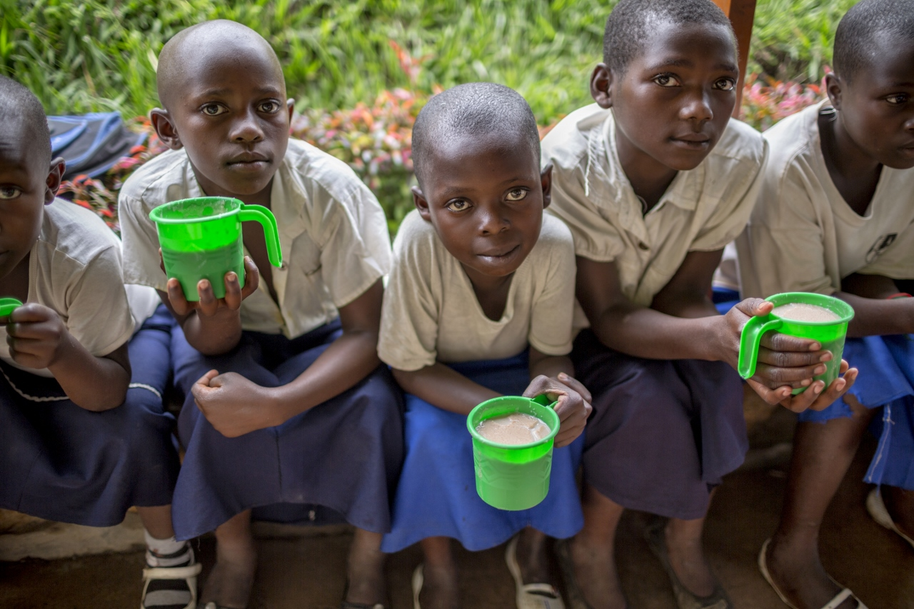 The kids eat their lunch in the green buckets. Amani Global Works provides this sort of porridge filled with nutrients and protein that is offered every day to all the girls in school and to the children that come from the malnutrition program:  150 kids are a part of this initiative and they show up at lunch time from their various homes to get this supplementary feeding.