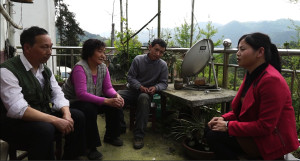 Liu Juan discussing the purchasing of relief supplies with village leaders. Photo by by Hu Wei /Oxfam