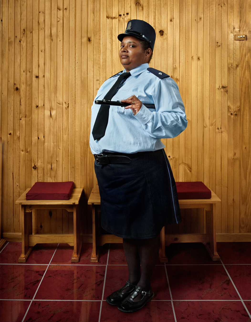 """Ruthy Goes to Church is a photographic documentary series about Ruth Jones, resident of Manenberg, a township outside Cape Town, South Africa. Ruthy Goes to Church is the 2nd part of Julia's ongoing project """"Proud Women of Africa"""" - a collection of short visual stories that portrays the daily lives of remarkable women living or working in Africa."""