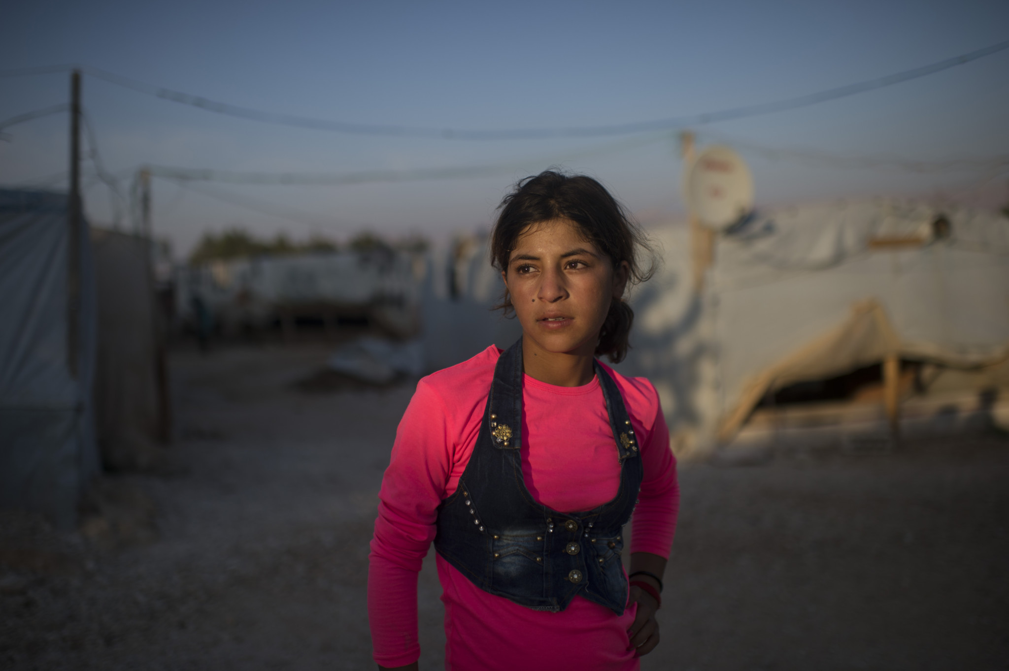Hanaa Abdullah, 12, poses for a portrait in the informal tented settlement she lives in with her family and other Syrian refugees,in the Bekaa Valley, between the city of Zahle and Baalbak, in Lebanon, August 1, 2015.  Hanaa and her family fled Syria in 2011 at the beginning of the Syrian civil war, and moved to this settlement two years ago, along with other Syrian refugees from Hasaka and the surrounding areas. Hanaa and other children in the settlement work for up to ten hours a day in agricultural lands owned by Lebanese in the area, and earn the equivalent of $5. per day.  Photographs by: Lynsey Addario/Getty Images Reportage