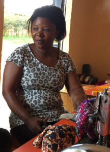 Adeline Chizungu who is also trained as a tailor, is sewing stuffed animals out of the bitenge.