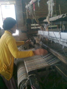 A returned Nepali migrant worker learns income-generating textile skills taught by the Migrant Women's Worker Group in Kathmandu. Photo Credit: Sunila Shrestha / MWWG