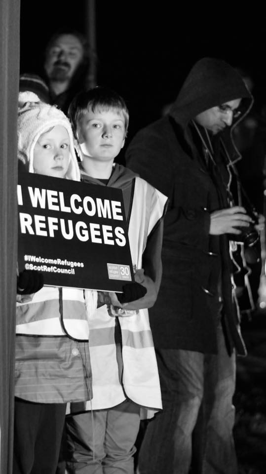 Dundonians show support for the arrival of refugees in the UK at a DRS 'Light Up the Law' event. (The Law is a large hill and the highest point in the city, atop of which sits Dundee's main war memorial).