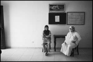 KUWAIT. Kuwait City. July 22, 2010. A Nepalese housemaid, her Kuwaiti sponsor and employer wait to process immigration paperwork inside the Nepalese embassy in Kuwait City.