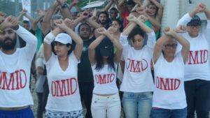 Refugees at Nauru wear t-shirts with the name of Omid Masoumali, an Iranian refugee who died after setting himself alight. Photo credit: Supply