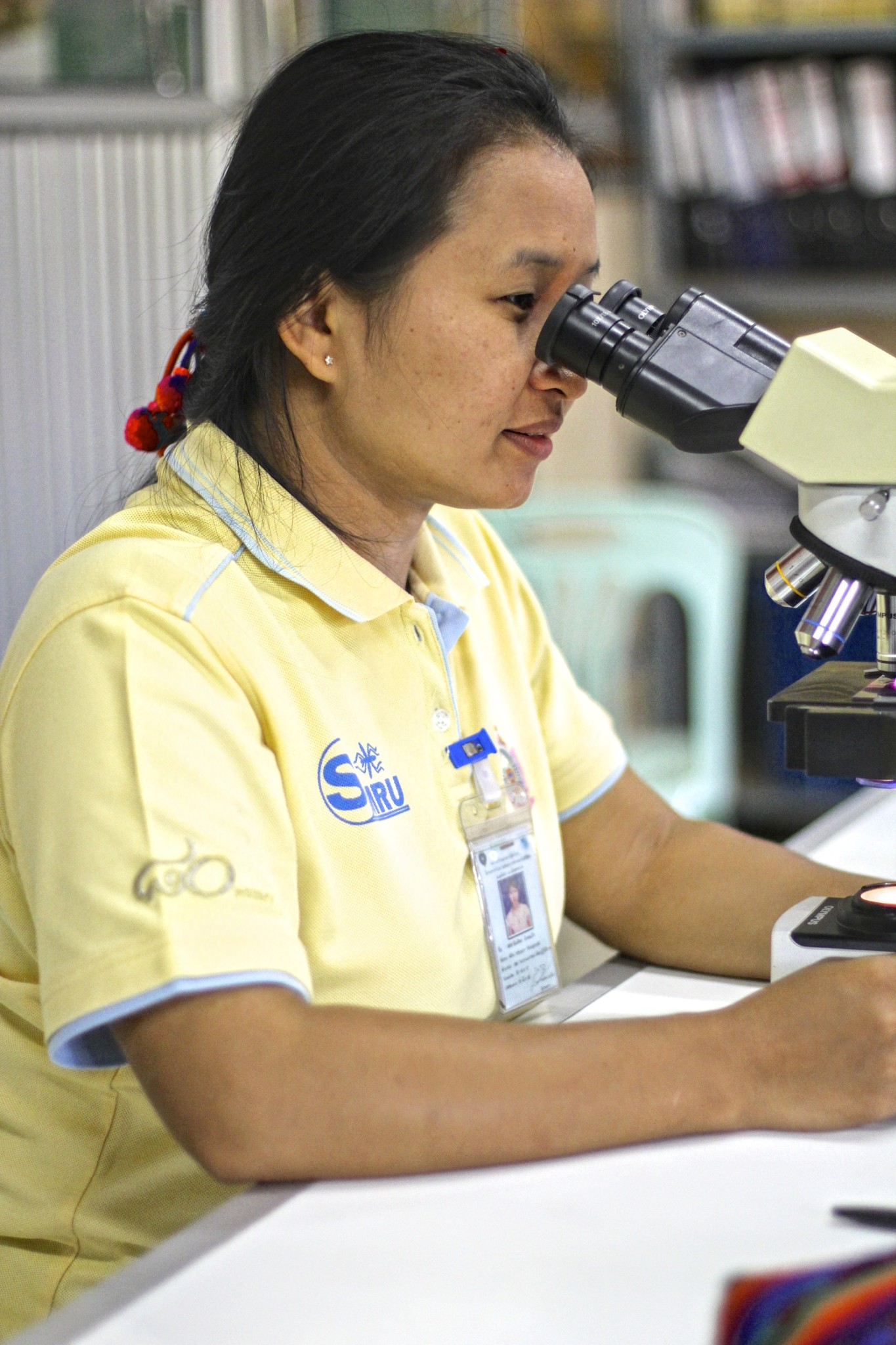 Young Malaria Microscopist is working in the Shoklo Malaria Research Unit at the border of Thailand Mynammar.  She  reads the stained blood slides under microscopy for malaria parasites.  She properly record all the test results and treatments in patient register.