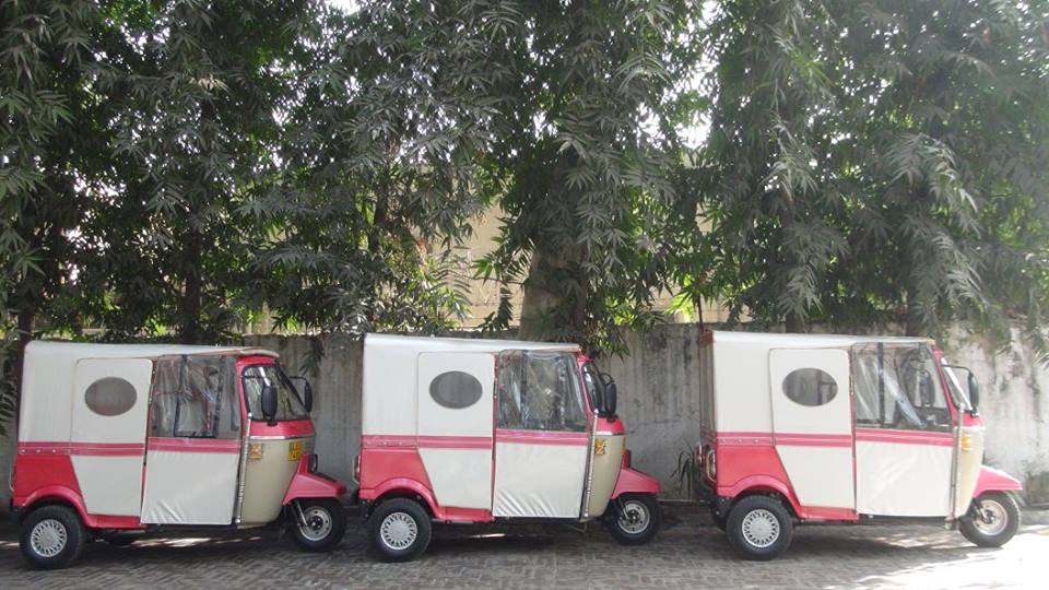 Shiny new Pink RIckshaws ready to be handed to their new owners at a ceremony in December 2016