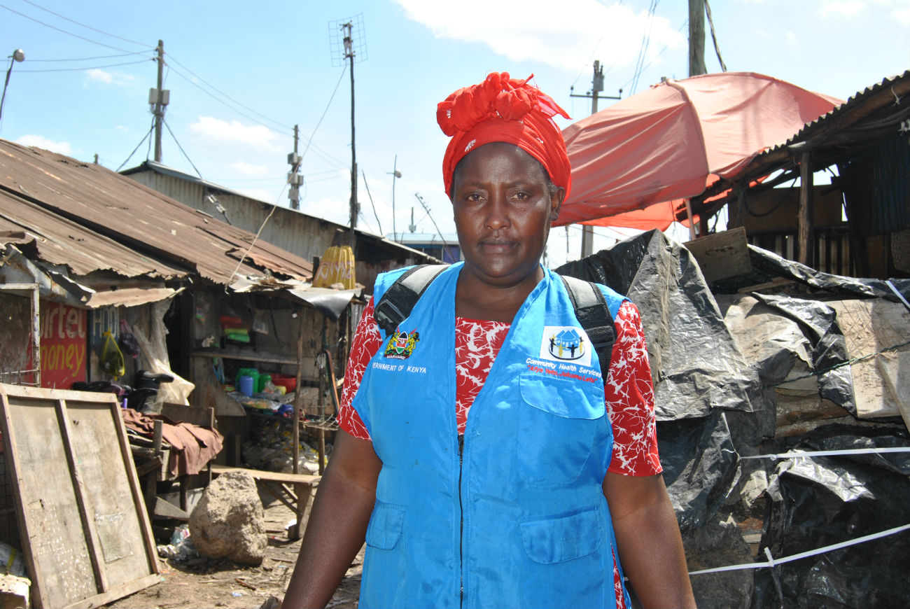 Mukonyo poses for a photo during her work in the slums.