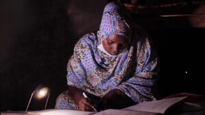 Zamzam Saka, a form two student studying at her parent's house in Kenya's Marsabit County